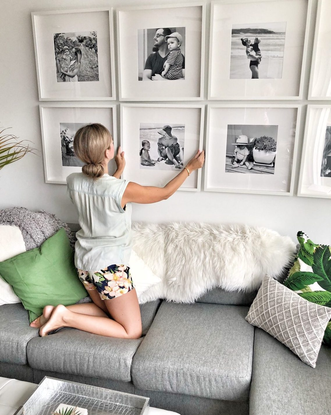 How to create a grid style gallery wall of family photos - Family pictures on living room wall ...